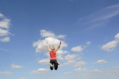 Young woman leaping Stock Photo