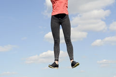 Young woman leaping Royalty Free Stock Image