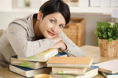 Young woman learning at home Stock Images