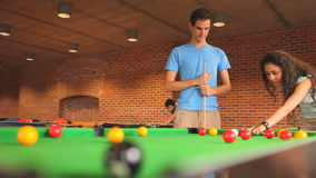 Young woman learning how to play pool stock footage