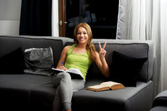 Young woman learning to exam on a sofa. Stock Photo