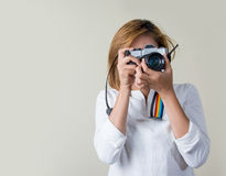 Young woman learning use camera. Girl learning use film camera Royalty Free Stock Images