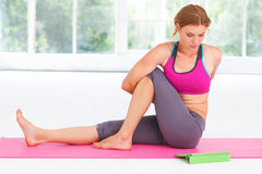 Young woman learning yoga with tablet. Royalty Free Stock Image