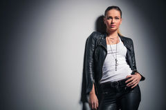 Young woman in leather clothes looks up Royalty Free Stock Photos