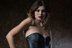 Young woman in leather corset. Beautiful young woman in leather corset stock photo