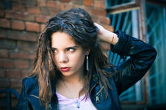 Young woman in  leather jacket Stock Image