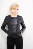 Young woman in leather jacket. Young blonde woman wearing black leather jacket Royalty Free Stock Images