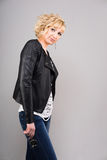 Young woman in leather jacket. Young blonde woman wearing black leather jacket Royalty Free Stock Image