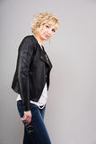 Young woman in leather jacket Stock Images