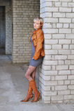Young woman in  leather jacket and boots Royalty Free Stock Image