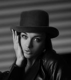 Young woman in leather jacket and hat Royalty Free Stock Photo