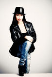 Young woman in leather jacket and hat Stock Photography