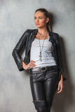 Young woman in leather jacket looks to side Royalty Free Stock Photos