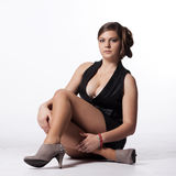 Young woman in leather jacket, miniskirt, high heels, with excep Royalty Free Stock Images