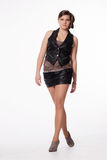 Young woman in leather jacket, miniskirt, high heels, with excep Royalty Free Stock Image
