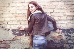 Young woman with leather jacket stock images