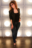 Young woman in a leather jackets in full length. Lamp wall background stock image