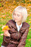 Young woman and leaves Stock Photos