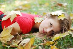 Young woman and leaves Royalty Free Stock Photo
