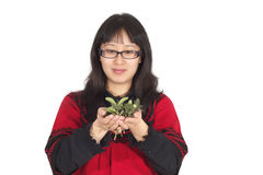 Young woman with leaves in hands with happiness. Stock Photography