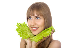 Young woman with leaves of lettuce isolated Royalty Free Stock Image
