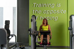 Young Woman on Leg Exercise Machine Royalty Free Stock Photo