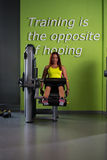 Young Woman on Leg Exercise Machine Royalty Free Stock Photography