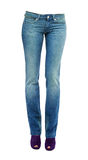 Young woman legs with clear blue jeans and purple peep toe pumps. Isolated on white background. Clipping path included Royalty Free Stock Photography