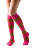 Young woman legs posing with pink striped socks Royalty Free Stock Images