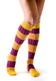 Young woman legs posing with purple and yellow striped socks Royalty Free Stock Photo