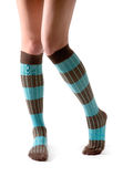 Young woman legs posing with turquoise striped socks Royalty Free Stock Photos