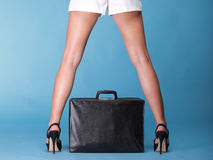 Young woman legs white dress and black travel bag Stock Photography