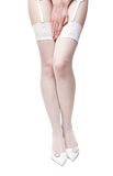 Young woman legs in white stockings Royalty Free Stock Photos