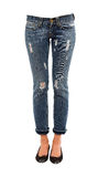 Young woman legs in worn jeans and sequins ballerinas Stock Photos