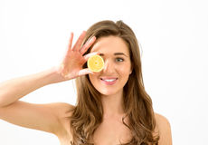 Young woman and lemon fruit Stock Photos