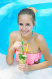 Young woman with lemonade in the pool Stock Photos