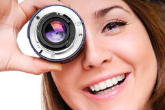 Young woman with a lens Royalty Free Stock Photography