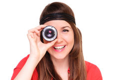 Young woman with a lens Royalty Free Stock Images