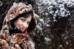 Young woman in leopard fur coat Royalty Free Stock Photo