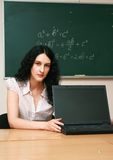 Young woman at the lesson. With laptop Stock Photos