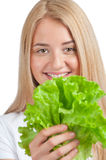 Young woman with lettuce Stock Photography
