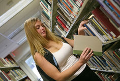 Young woman in library Stock Image