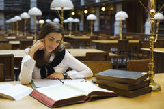 Young woman in library stock photography