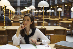 Young woman in library Royalty Free Stock Photos
