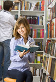 Young woman in the library Royalty Free Stock Photography
