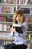 Young woman  in the library Stock Photo