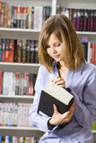 Young woman  in the library Royalty Free Stock Image