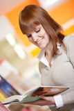 Young woman in a library Stock Photography