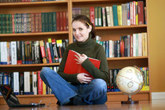 Young woman in library Royalty Free Stock Image