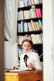 A young woman in the library Stock Photography